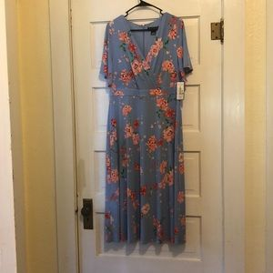 Never worn!! Flowery dress!! With tags!!